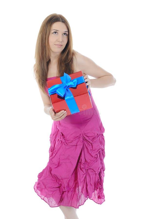 Jonge vrouw met een gift. stock afbeeldingen