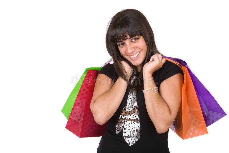 Jonge vrouw met een paar het winkelen zakken stock afbeeldingen