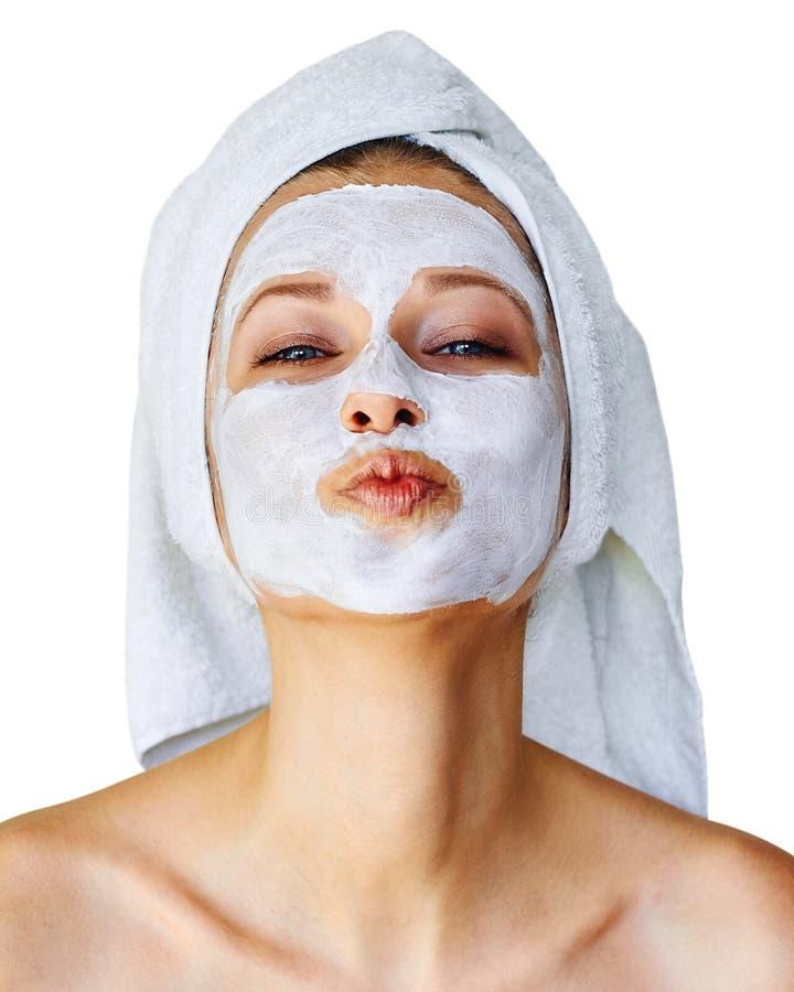 Jonge vrouw met gezichtsmasker op haar gezicht Over geïsoleerde huidzorg en behandeling, kuuroord, natuurlijk schoonheid en de ko royalty-vrije stock foto