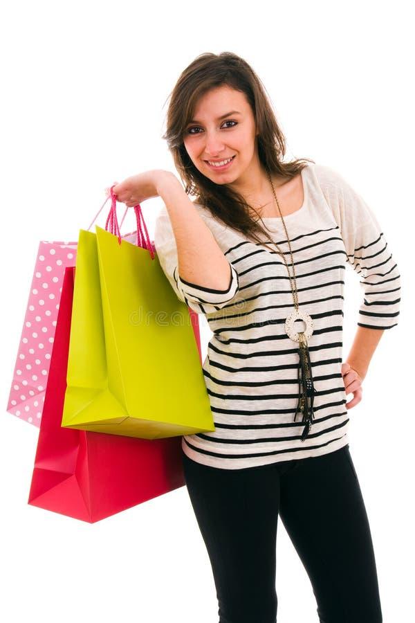 Jonge vrouw met het winkelen zakken stock foto's