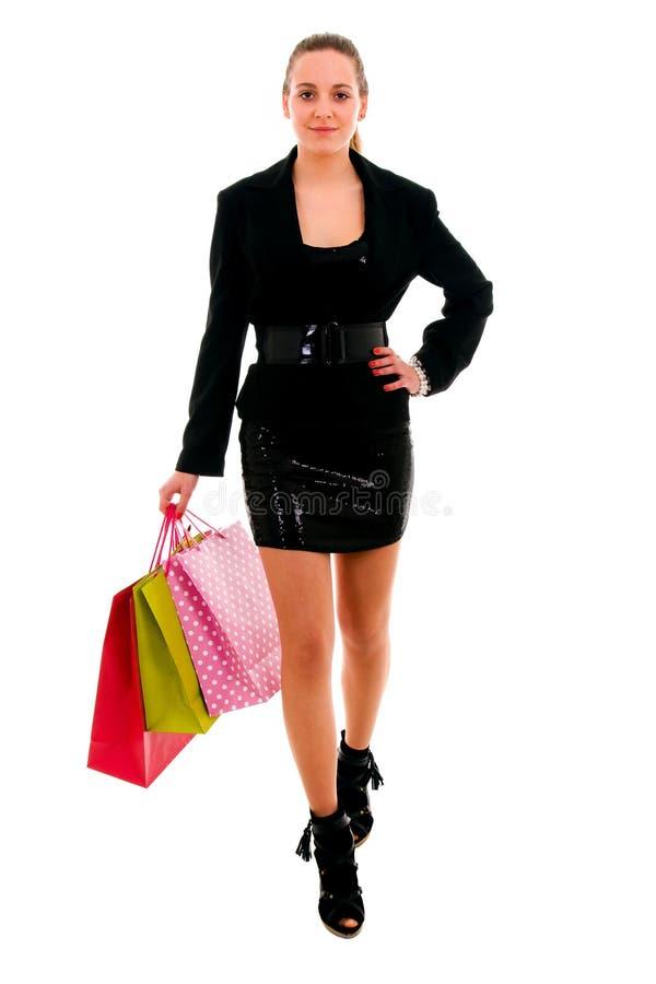Jonge vrouw met het winkelen zakken, die op wit wordt geïsoleerdg royalty-vrije stock fotografie