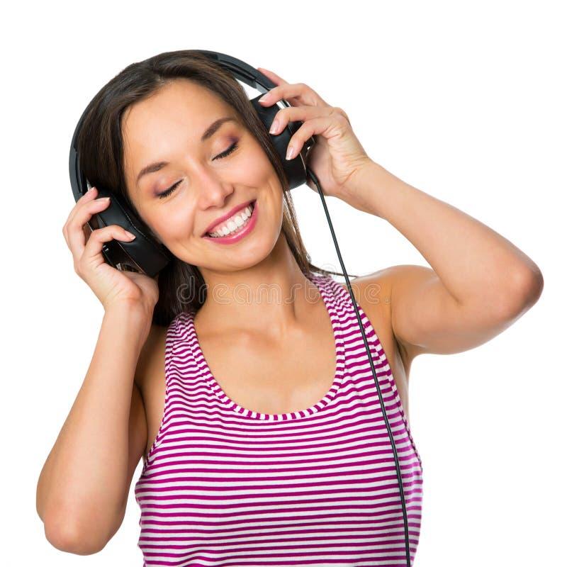 Jonge vrouw met hoofdtelefoons het luisteren muziek Het meisje van de muziektiener stock afbeeldingen