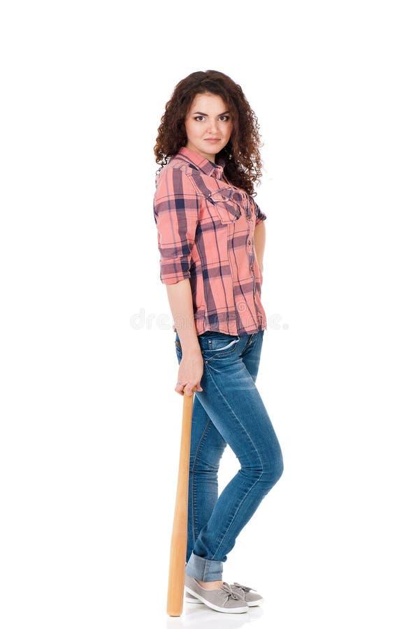 Jonge vrouw met houten honkbalknuppel stock foto