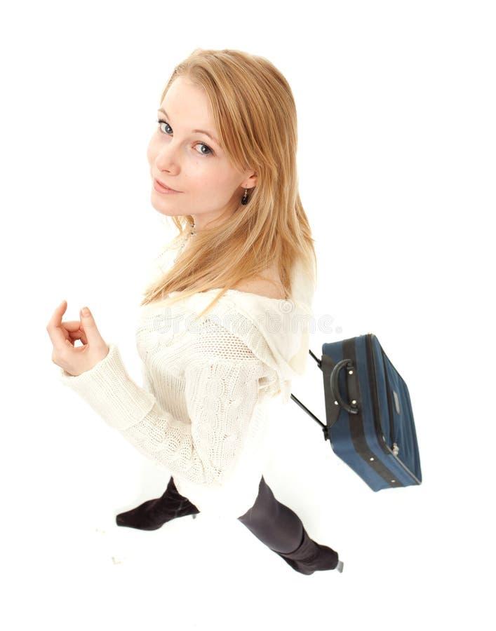 Jonge vrouw met koffer stock foto