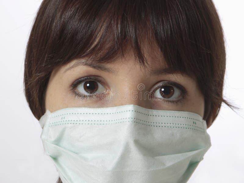 jonge vrouw met medisch masker stock foto's