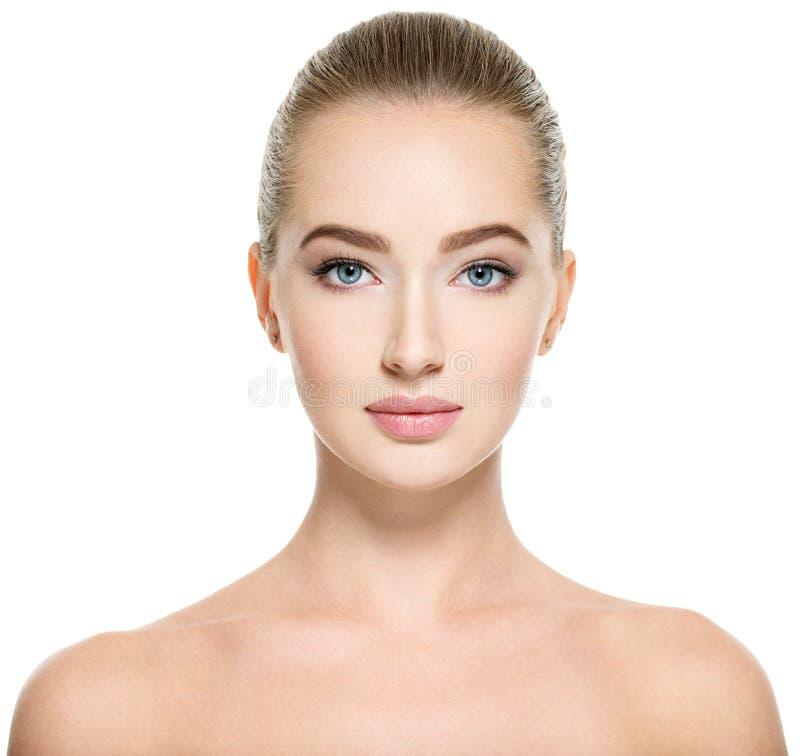 Jonge vrouw met mooi gezicht stock foto
