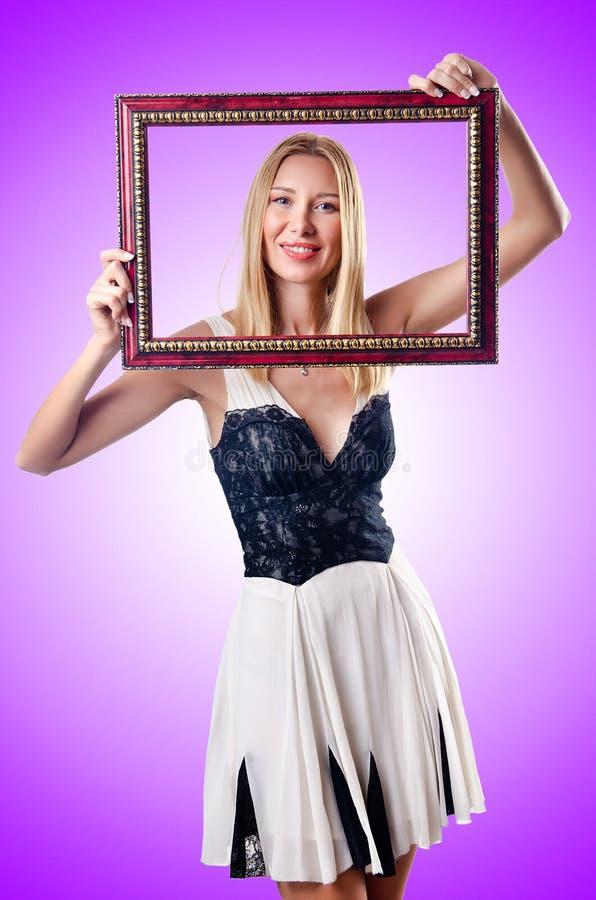 Jonge vrouw met omlijsting op wit royalty-vrije stock afbeelding