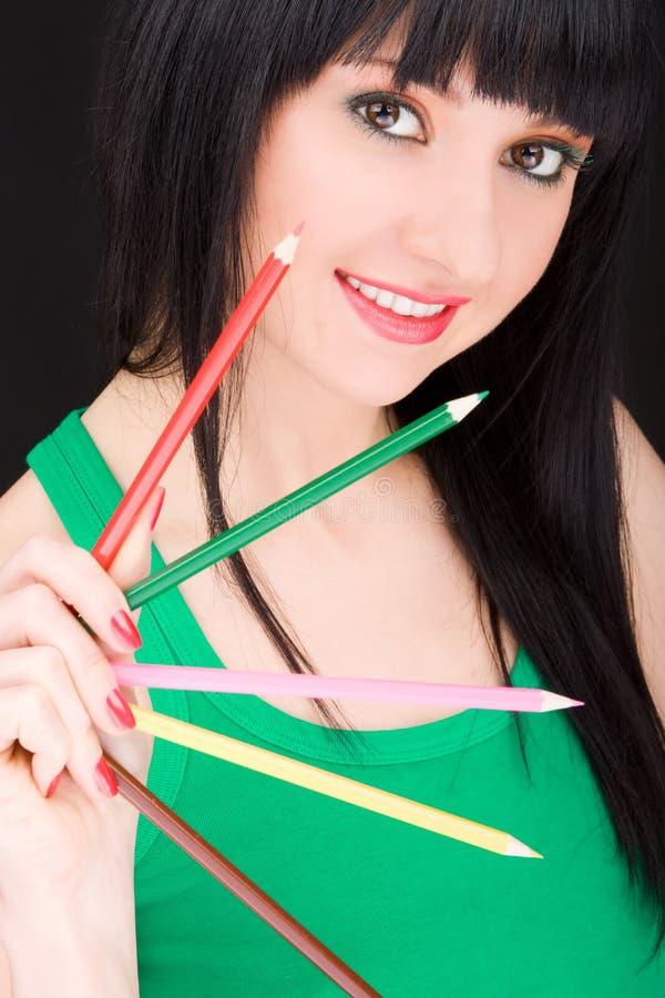 Jonge vrouw met potloden stock fotografie
