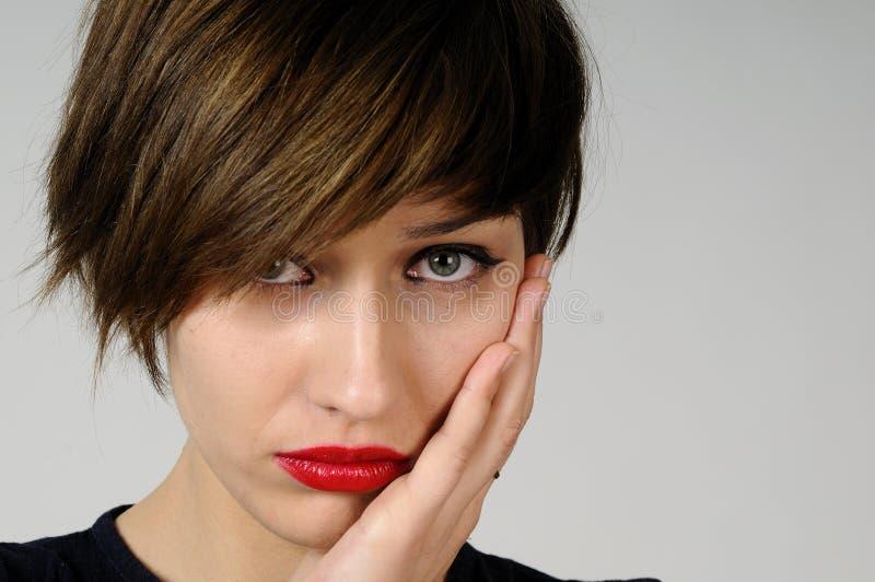 Jonge vrouw met tandpijn royalty-vrije stock afbeelding