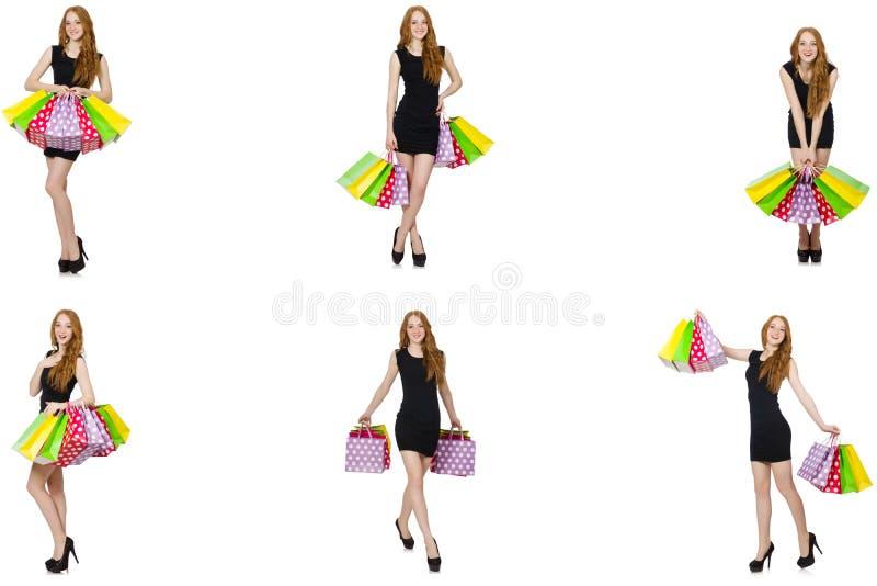Jonge vrouw met zakken in shopaholic concept stock foto's