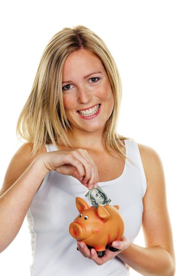 Jonge vrouw, om geld te besparen. De Rekening van de dollar stock fotografie