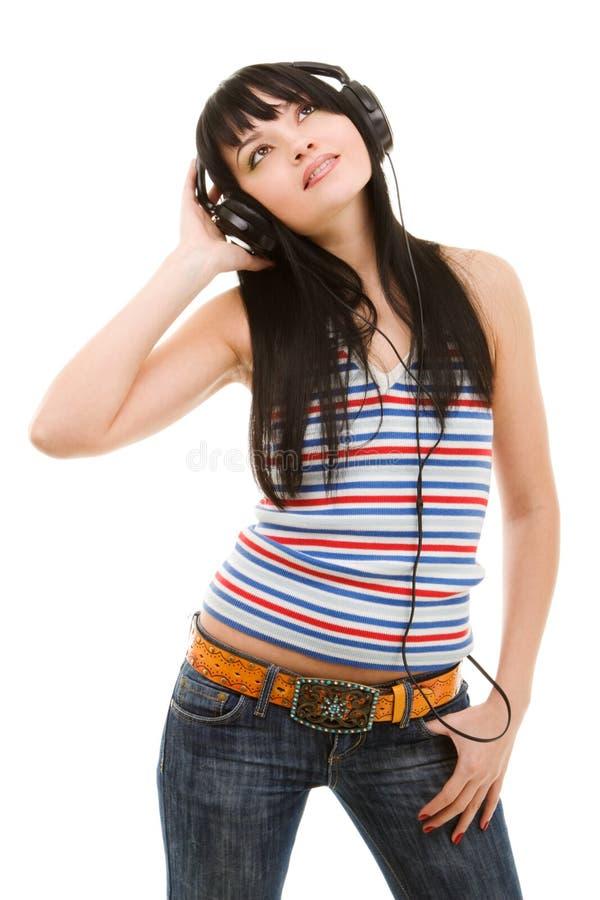 Jonge vrouw in oortelefoons royalty-vrije stock fotografie