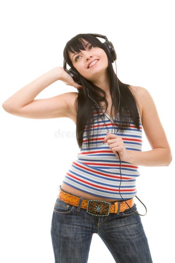 Jonge vrouw in oortelefoons royalty-vrije stock afbeeldingen
