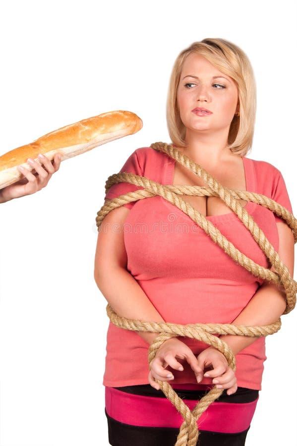 Jonge vrouw op dieet stock afbeelding