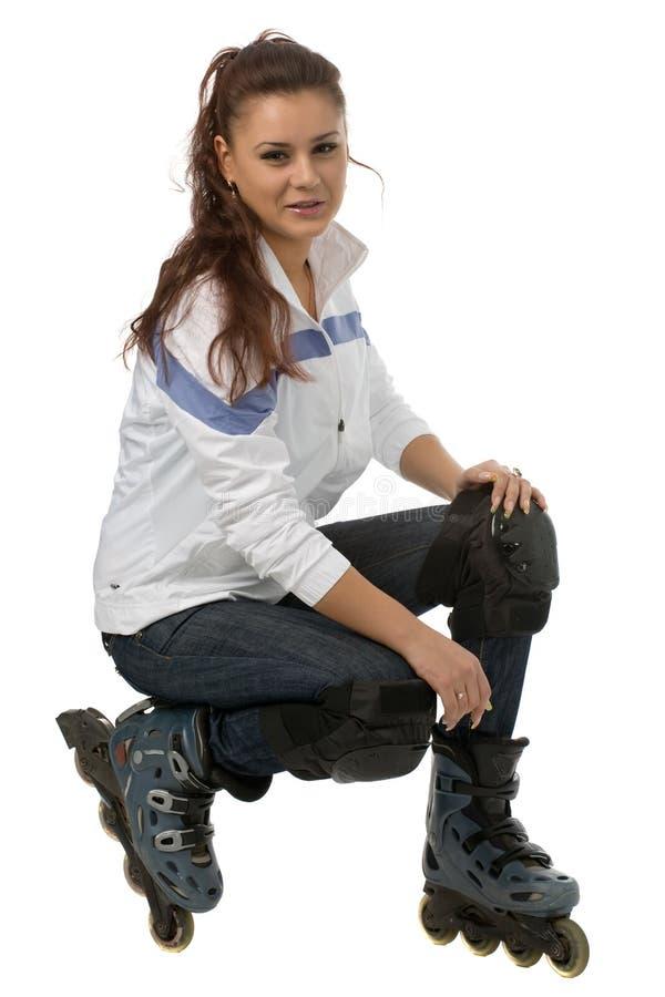 Jonge vrouw in rolbladen royalty-vrije stock afbeeldingen