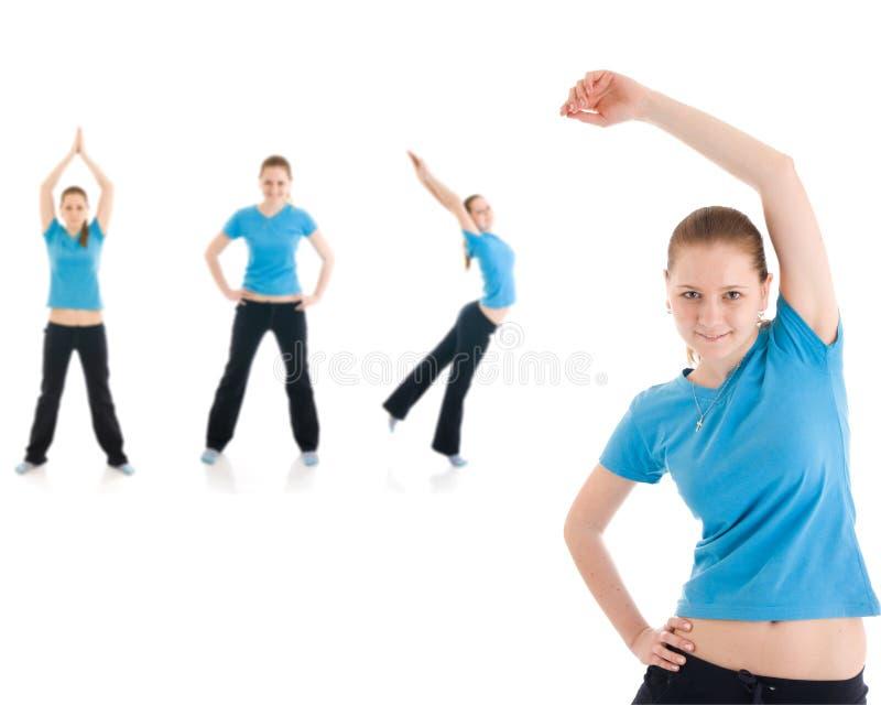 Jonge vrouw vier die geïsoleerde oefening doet royalty-vrije stock afbeelding