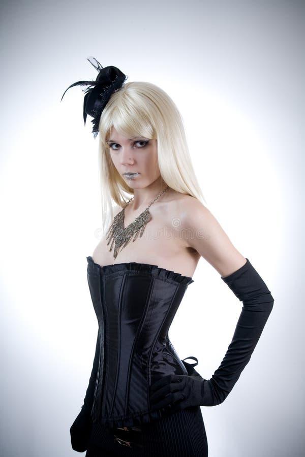 Jonge vrouw in zwart korset stock afbeeldingen