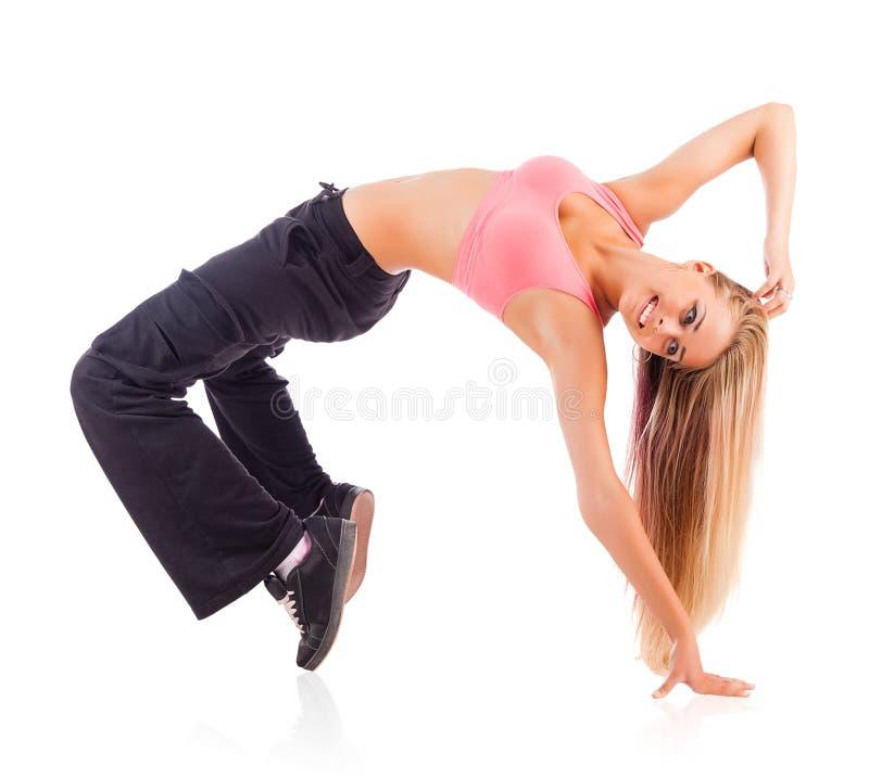 Jonge vrouwelijke danser op witte achtergrond stock fotografie