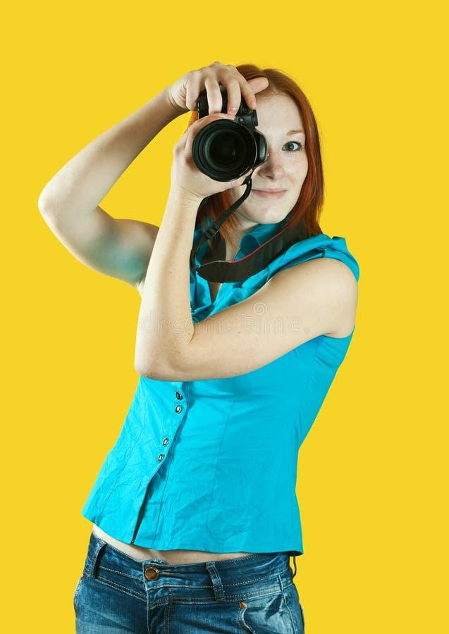 Jonge vrouwelijke fotograaf royalty-vrije stock afbeeldingen