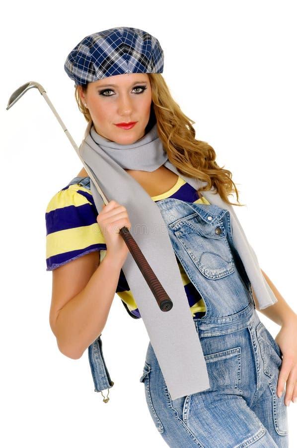 Jonge vrouwelijke golfspeler stock foto's
