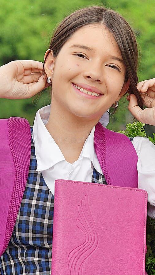 Jonge Vrouwelijke Student Touching Hair royalty-vrije stock afbeelding