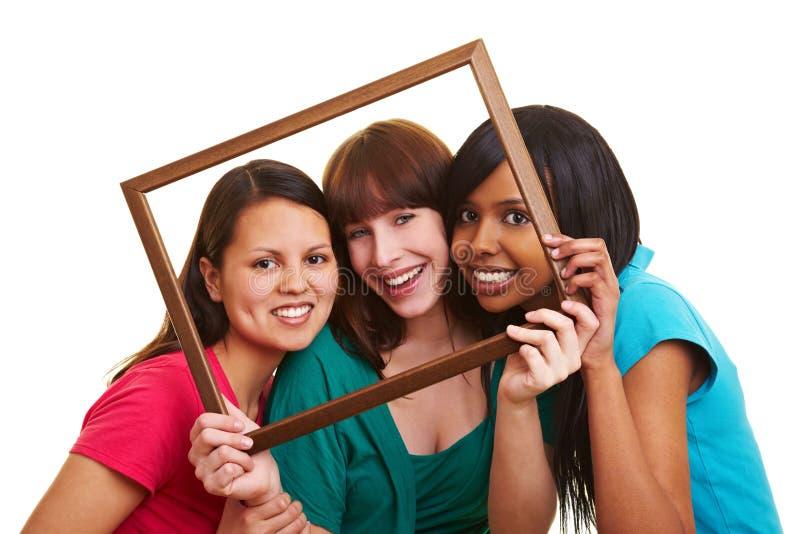 Jonge vrouwen in een frame stock fotografie