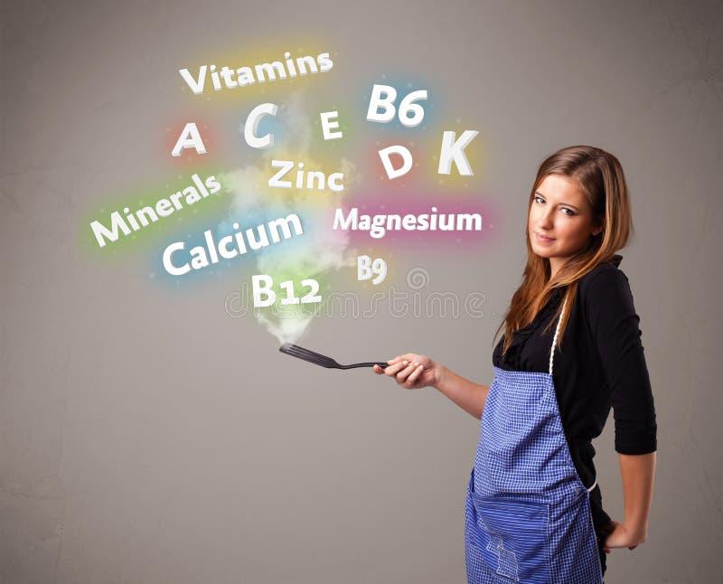 Jonge vrouwen kokende vitaminen en mineralen stock illustratie