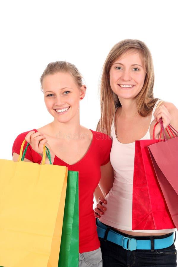 Jonge vrouwen met het winkelen zakken stock foto's