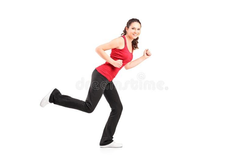 Jonge vrouwenjogging en het bekijken camera stock afbeelding