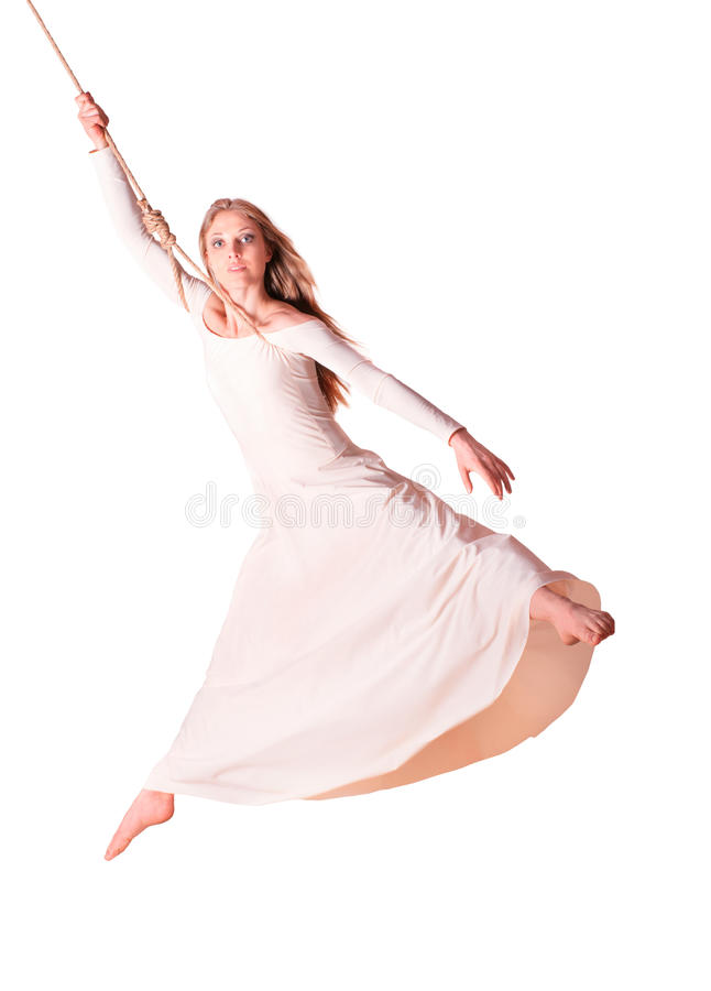 Jonge vrouwenturner in witte kleding op kabel. royalty-vrije stock foto