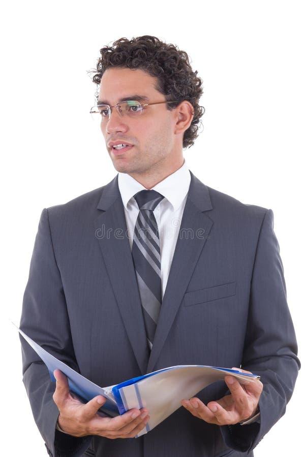 Jonge zakenman die een open notitieboekje houden stock afbeelding