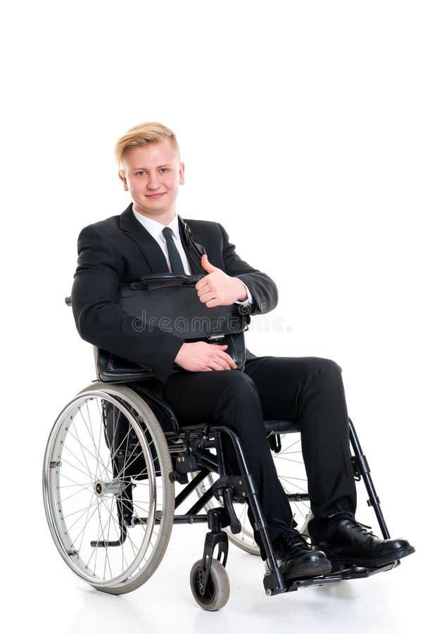 Jonge zakenman in een rolstoel met omhoog duim royalty-vrije stock afbeelding