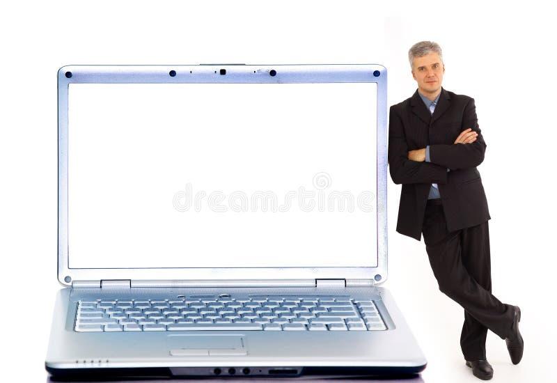 Jonge zakenman en laptop stock afbeeldingen