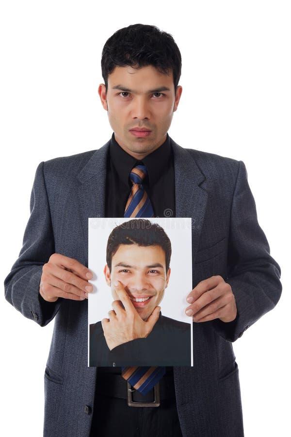 Jonge zakenman en zijn bewustzijn royalty-vrije stock foto