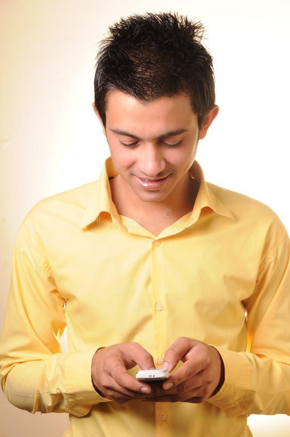 Jonge Zakenman met celtelefoon stock afbeeldingen