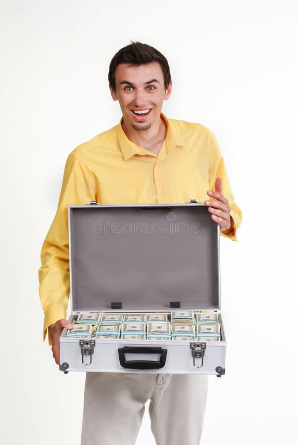 Jonge zakenman met kofferhoogtepunt van geld royalty-vrije stock foto
