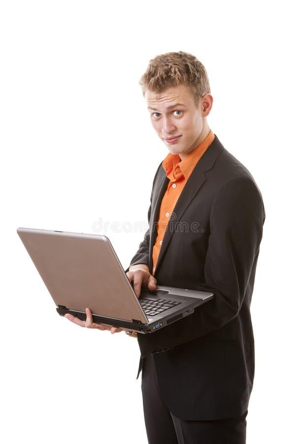 Jonge zakenman met laptop stock afbeelding