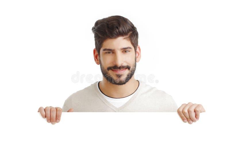 Jonge zakenman met leeg uithangbord stock afbeelding