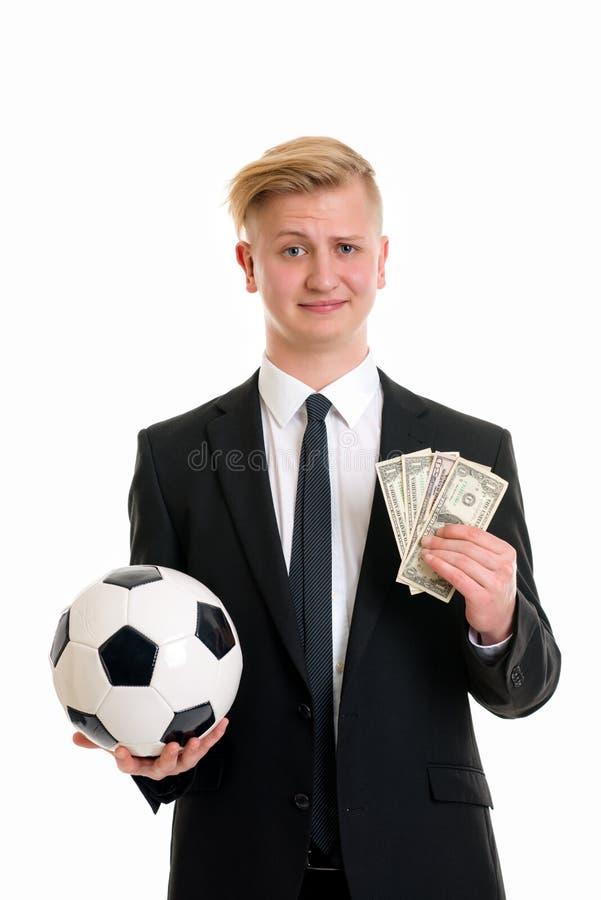 Jonge zakenman met voetbalbal en geld royalty-vrije stock fotografie