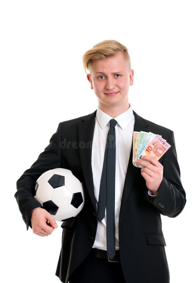 Jonge zakenman met voetbalbal en geld stock fotografie