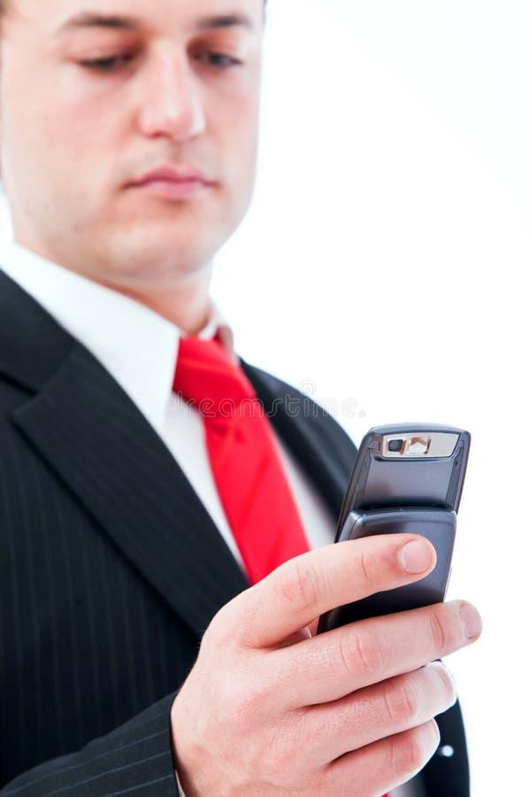 Jonge zakenman op de telefoon stock foto