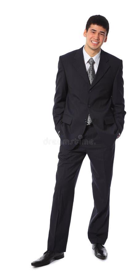 Jongelui die Aziatisch zakenman volledig lichaam glimlachen royalty-vrije stock foto's