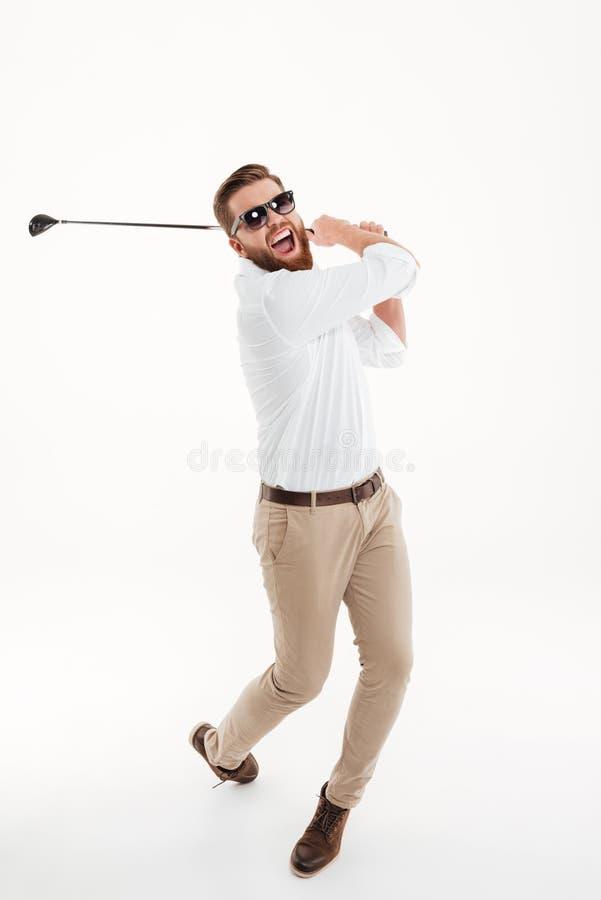 Jongelui die emotionele gebaarde mensenholding gillen golfstick stock afbeelding