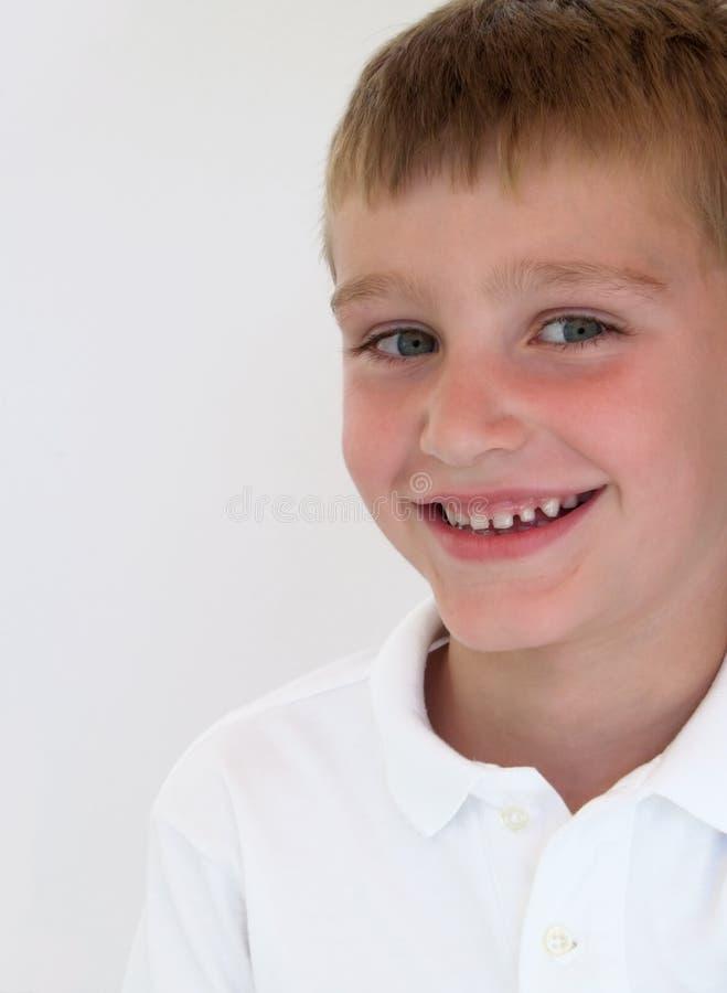 Jongen die 3 glimlacht stock foto's