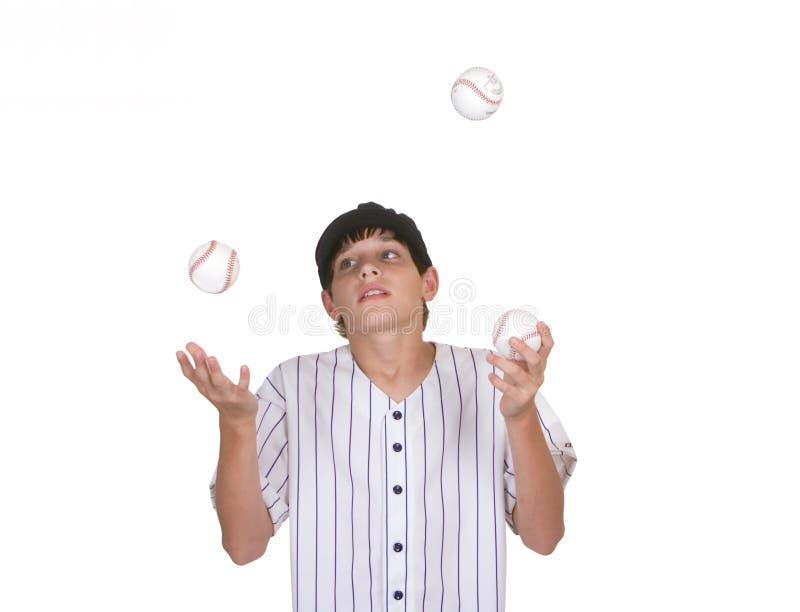 Jongen die baseballs jongleert met royalty-vrije stock afbeelding