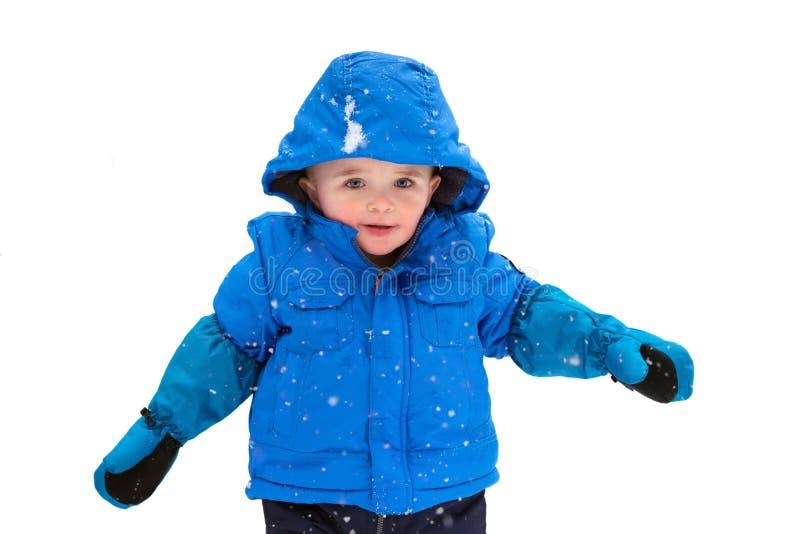 Jongen die in een Geïsoleerde Snowsuit glimlachen - royalty-vrije stock fotografie