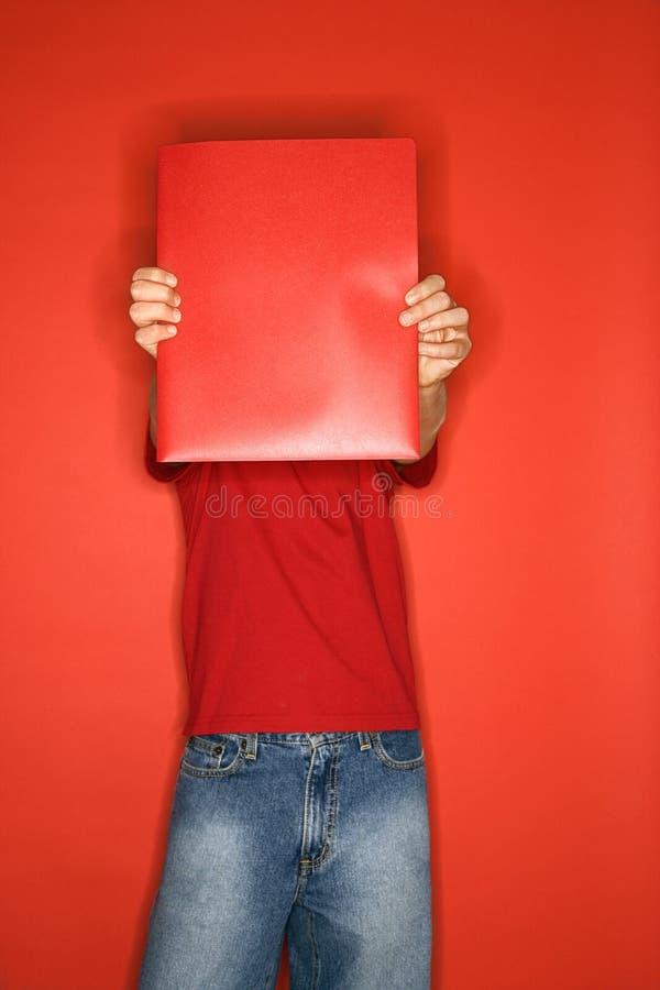 Jongen die gezicht behandelt met omslag. stock fotografie