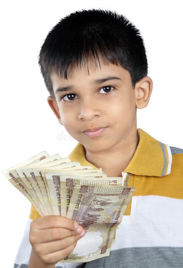 Jongen die het geld met Uitdrukking houden stock foto's