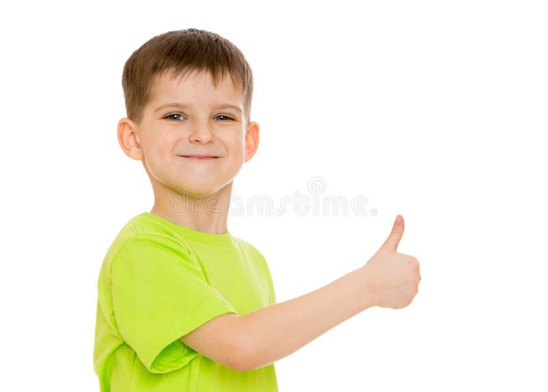 Jongen die makend de bewegingen van het handgebaar glimlachen of stock afbeeldingen