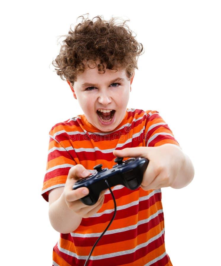 Jongen die videospelletjecontrolemechanisme met behulp van royalty-vrije stock afbeeldingen